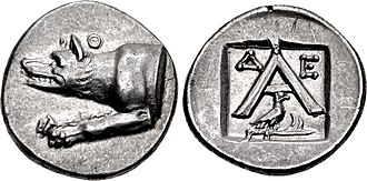Argos - Triobol of Argos, minted between 270 and 250 BC.  The obverse depicts the forepart of a wolf, alluding to Apollo Lykeios, the patron-god of the city.  The A on the reverse is simply the initial of Argos.