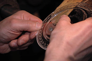 Glass engraving - Use of an abrasive wheel to engrave a glass dish (Italy)