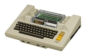 Atari 8-bit family - The Atari 800 with the top flap removed, showing the expansion cards and two cartridge slots. The slots are moulded into the cast aluminum RF shield.