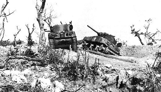 Two US M4 Sherman tanks knocked out by Japanese artillery at Bloody Ridge, April 20, 1945 Attack on bloody ridge.jpg