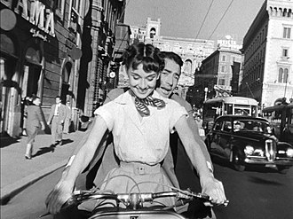 Roman Holiday with Audrey Hepburn and Gregory Peck, 1953 Audrey Hepburn and Gregory Peck on Vespa in Roman Holiday trailer.jpg