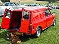 Austin-Morris Mini Van Royal Mail 1973-4 with Micha the Boxer dog seeking the shade (14515346099).jpg