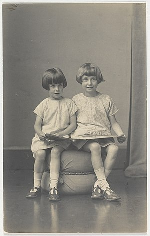 Elizabeth Jolley - Elizabeth Jolley and (younger) sister Madelaine Winifred reading, ca. 1927