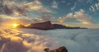Table Mountain - Table Mountain seen from Lion's Head with low-lying cloud cover over Cape Town.