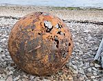Badentarbat Bay - corroded buoy on the beach.jpg
