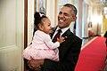 Barack Obama holds the daughter of former staff member Darienne Page Rakestraw, 2015.jpg
