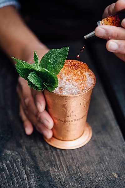 File:Bartender making a cocktail (Unsplash).jpg