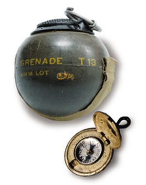 Office of Strategic Services - OSS T13 Beano Grenade and compass hidden in a button, CIA Museum