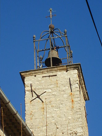 Mistral (wind) - The bell tower of the hilltop village of La Cadière-d'Azur is open, which allows the mistral to pass through.