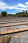 The garden of remembrance is laid out with slates. It is surrounded with a trellis. It has a sandst This cemetery contains the mortal remains of 1 737 women and children who died during the Anglo-Boer War (1899-1902) in the concentration camp at Bethulie. The cemetery, which was designed by J. do Toit, was inaugurated on 10 October 1966 by the then Stat Type of site: Concentration Camp Cemetery Current use: Cemetery.
