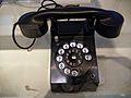 Black rotary dial telephone.jpg