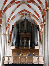 Photo of interior of the church with organ featured prominently
