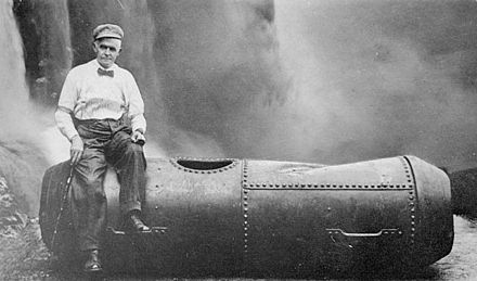 Bobby Leach and his barrel after his trip over Niagara Falls, (1911 photo) BobbyLeachNiagaraFalls.jpg