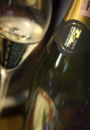 A bottle displaying the Franciacorta DOCG logo...