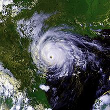 A mature hurricane with a well-defined, cloud free eye over southern Texas. The Gulf of Mexico can easily be seen to the right of the storm and Mexico to the left. Parts of the southern United States are also in the top of the image.