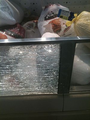 Toughened glass - Tempered safety glass, which has been laminated, often does not fall out of its frame when it breaks – usually due to the anti-splinter film applied on the glass, as seen in this grocery store meat case.
