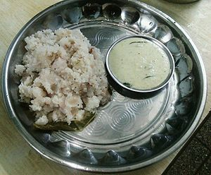 Broken rice - An upma dish of broken rice cooked with onions, chilli and ginger, and served with coconut chutney, from India