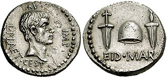 "Brutus the Younger - EID MAR (""Ides of March"") denarius, issued by Marcus Junius Brutus in 43/42 BC. The obverse of the coin features a portrait of Marcus Brutus. The inscription reads BRVT IMP L PLAET CEST, which means Brutus, Imperator, Lucius Plaetorius Cestianus. Lucius Plaetorius Cestianus was the moneyer who actually managed the mint workers who produced the coin. The two daggers on the reverse differ to show more than one person was involved in the slaying. The cap is a pileus (liberty cap) that in Roman times was given to slaves on the day of their emancipation – freedom from slavery. In the context of the assassination, Brutus is making it clear the killers were defending the Republic and its people from Caesar's attempt to attain kingship. A gold aureus with the same design was also minted. Both coins are exceptionally rare."