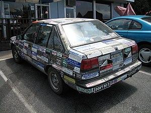 Bumper sticker car parked in Santa Cruz, California..