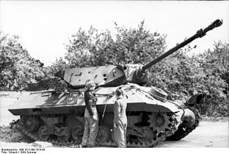 17pdr SP Achilles - German personnel examine an Achilles of 245 Battery, 62nd Regiment, Royal Artillery, knocked out in Normandy, 1944. Three penetrating hits are visible on the turret.