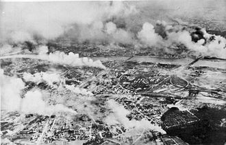 Strategic bombing during World War II - Warsaw burning after a German bombing of the city. The Luftwaffe air campaign resulted in the deaths of an estimated 20,000 – 25,000 civilians.