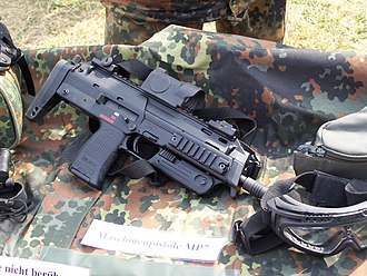Heckler & Koch MP7 - A recent production MP7A1 (note the safety trigger) with a Zeiss RSA reflex red dot sight on display as part of Germany's IdZ program.