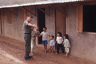 Officer in Charge of Construction RVN - CDR E.H.Belton, CEC, USN showing housing for Vietnamese Navy families at Long Binh, Vietnam in 1972