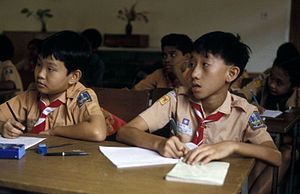 Education in Indonesia - Students wearing the pramuka (boy scout) uniform studying. This uniform is usually worn on either Friday or Saturday.