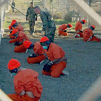 Captives upon arrival at Camp X-Ray, January 2002