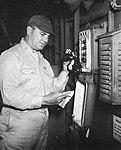 Captain Jackson R. Tate, USN, announces the surrender of Japan aboard the aircraft carrier USS Randolph (CV-15) on 15 August 1945.jpg