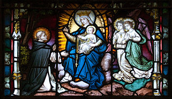 Detail of a stained glass window featuring St....