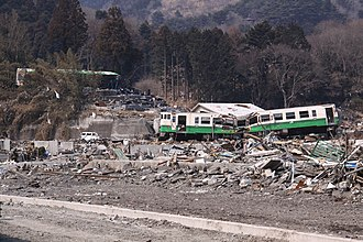 Ishinomaki Line - The remains of a train hit by the tsunami that hit in March 2011 among a scattered cemetery in Onagawa.