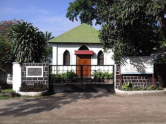 "American Baptist International Ministries - The first chapel in the proximity of Kintambo, now ""avenue de l'Avenir"", quartier Basoko, Ngaliema, founded 1891 by Sims Aaron, legal representative to ABFMS."