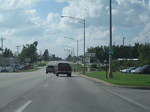 Business route - Business Loop I-44 in Springfield, Missouri, was once part of Route 66. Its status is shown by the green business interstate marker attached to the lamppost.