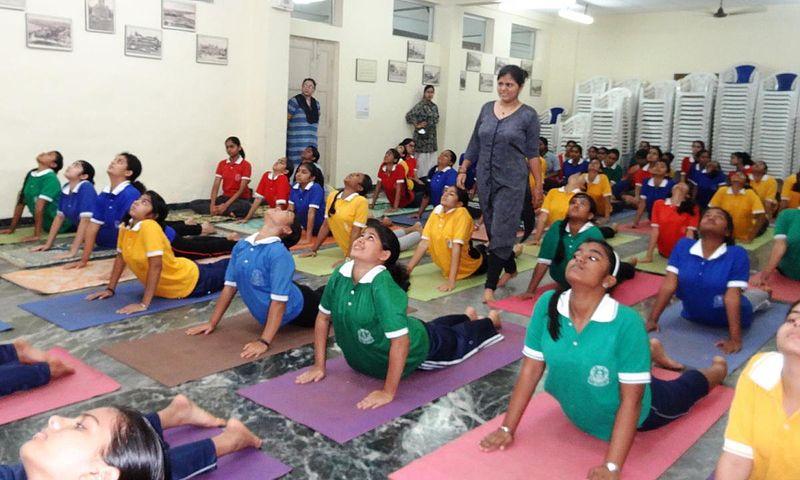 File:Children perform yoga at the Naval Children School, Mumbai in 2015.jpg