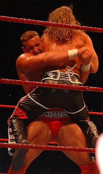 Bear hug - Chris Masters applying a bear hug from the front on Shawn Michaels.
