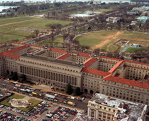 Herbert C. Hoover Building - Aerial view from 14th Street, with the Hoover Building in the foreground and its six courtyards visible. In the background is President's Park.