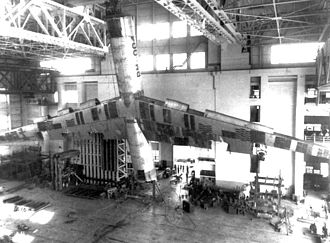 Convair B-36 Peacemaker - A B-36 airframe undergoing structural stability tests. Note for scale the three men in the balcony at the extreme right of the photograph.