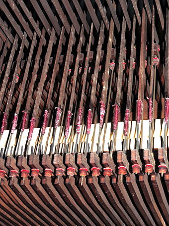 Tracker action showing adjusters on tracker ends which engage with the keys of the great organ. Cradley Heath Baptist Church Organ A03.JPG