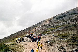 "Lughnasadh - Pilgrims climbing Croagh Patrick on ""Reek Sunday"". It is believed that climbing hills and mountains was a big part of the festival since ancient times, and the ""Reek Sunday"" pilgrimage is likely a continuation of this."