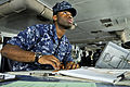 Defense.gov News Photo 120115-N-JN612-022 - U.S. Navy Seaman Roosevelt Feazell charts a course from the bridge of the aircraft carrier USS Abraham Lincoln in the U.S. 7th Fleet area of.jpg