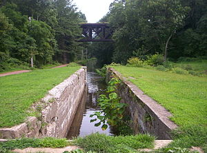 Delaware Canal State Park - A view of the park, with the towpath at left and the West Trenton Line rail in the background