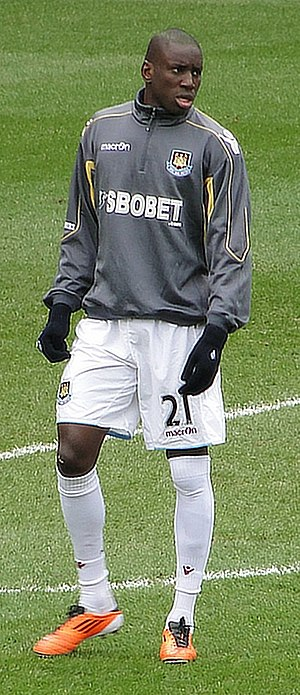 Football boot - Footballer Demba Ba wearing orange boots