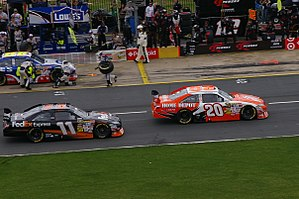 Joe Gibbs Racing - Joey Logano (No. 20) and Denny Hamlin (No. 11) on pit road during the 2009 Coca-Cola 600.
