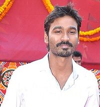 A picture of Dhanush as he looks at the camera