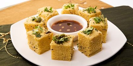 Dhokla, steamed chickpea snack Dhokla on Gujrart.jpg