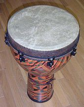 Fibreglass djembe with synthetic skin and lug tuning system