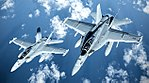 EA-18G Growlers of VAQ-209 in flight over the Pacific Ocean on 31 January 2016.jpg