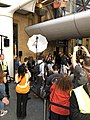 Eddie Redmayne (Fantastic Beasts) with fans in King's Cross station in London at platform 9 3-4.jpg