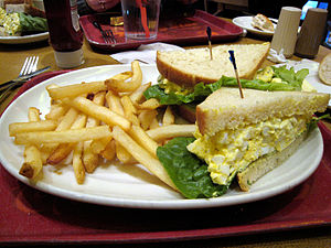 Egg sandwich - An egg salad sandwich with french fries